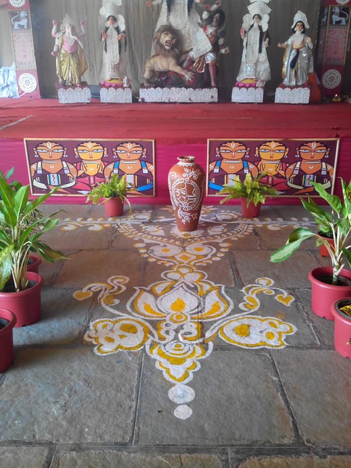 'Alpona' decoration in front of goddess Durga in pooja