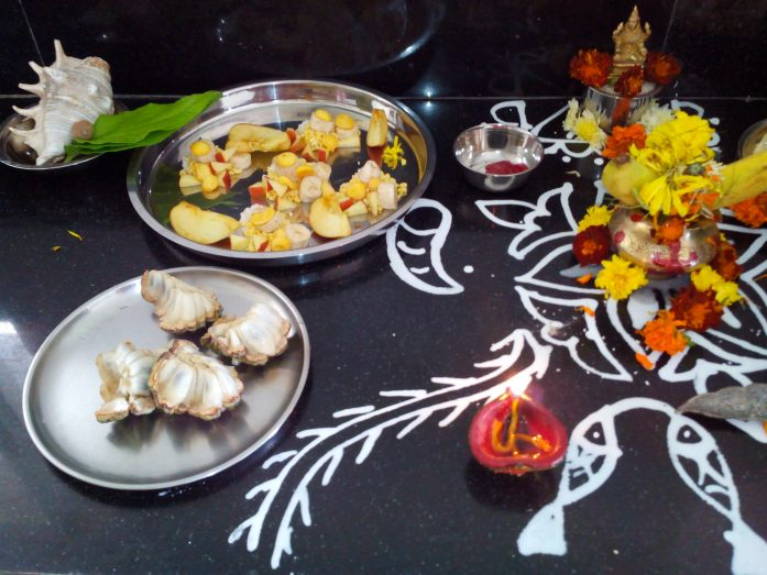 Kojagiri Laxmi pooja with the design of wheat branch & a pair of fish.