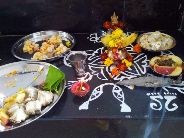 Kojagiri Laxmi pooja with the traditional design made by ground rice 'alpona'.