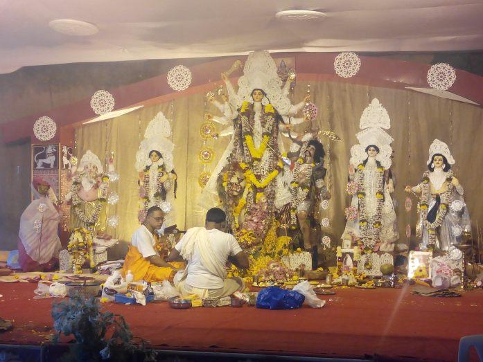 A view of the purohits / pandits offering ashtami pooja to Goddess Durga.
