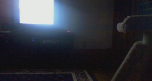 TV playing in the dark room
