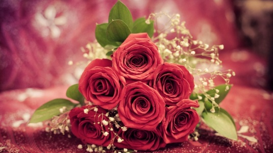 flower bouquet of red roses on a red table