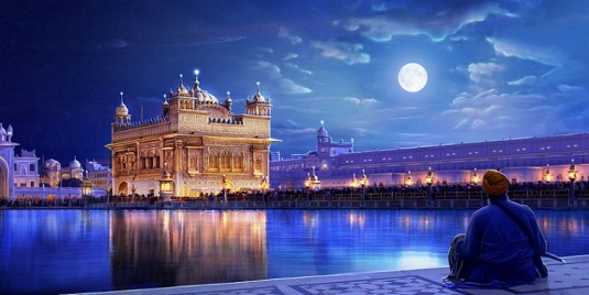 The Golden temple (gurudwara) of Sikhs on lake on a moonlit night in Amritsar, Punjab, India.